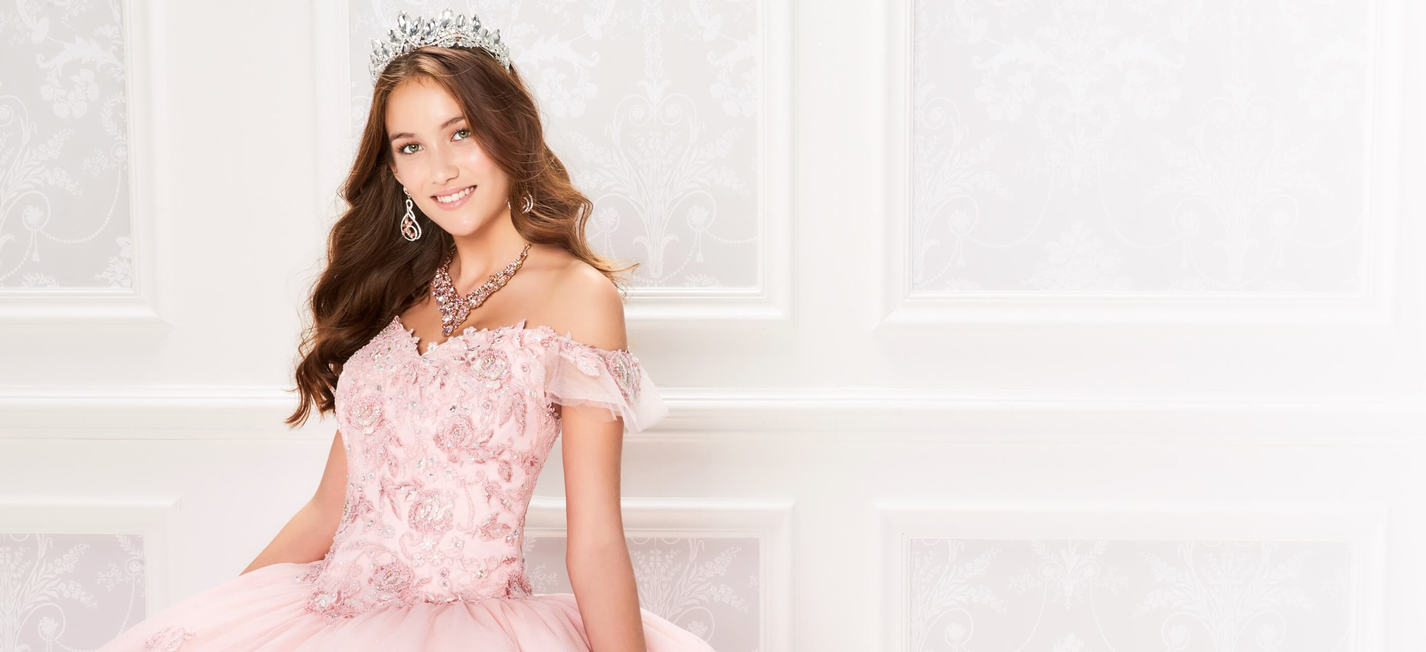 Model wearing a pink Quinceanera dress
