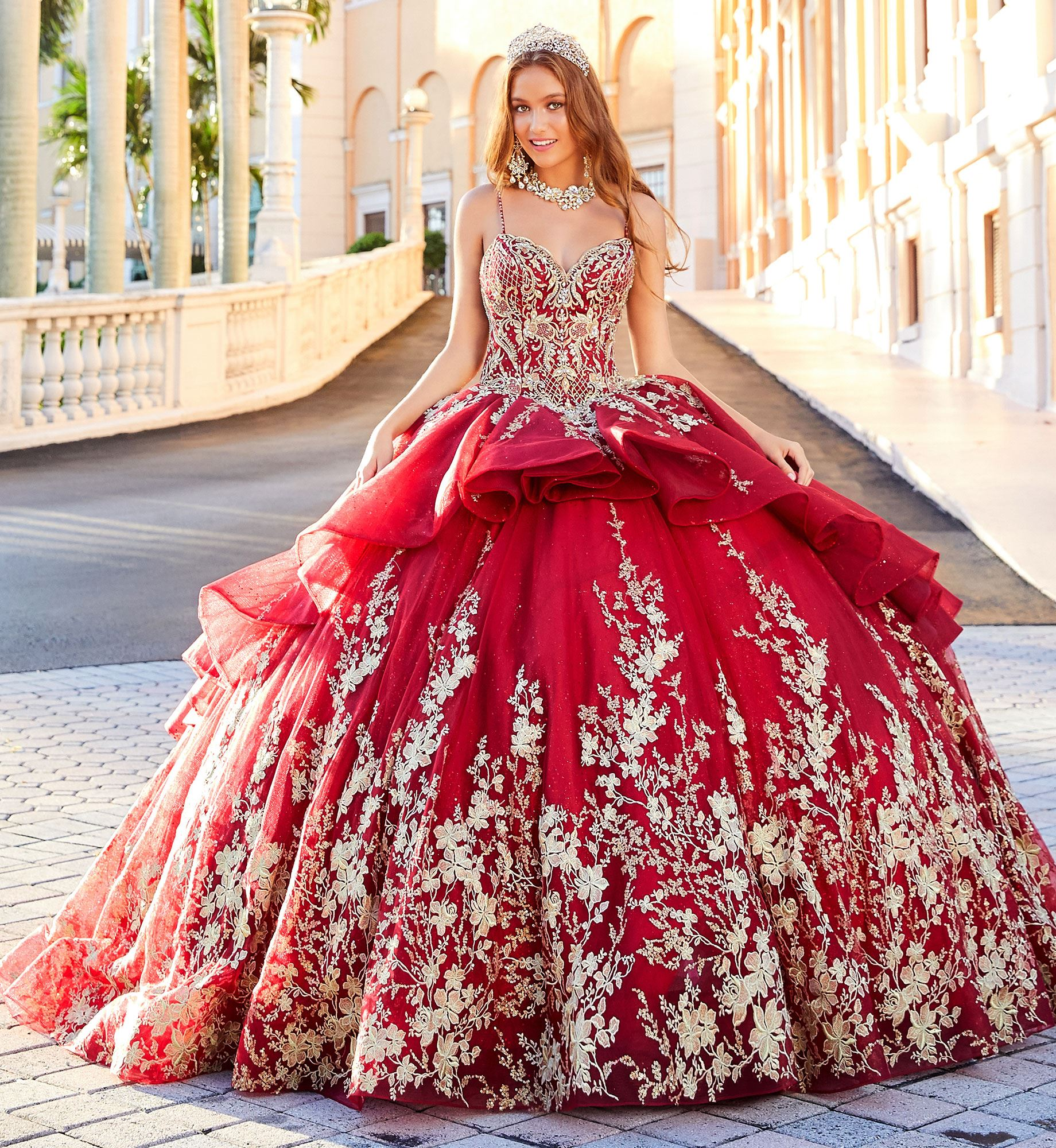 Brunette model in red and gold quinceañera dress