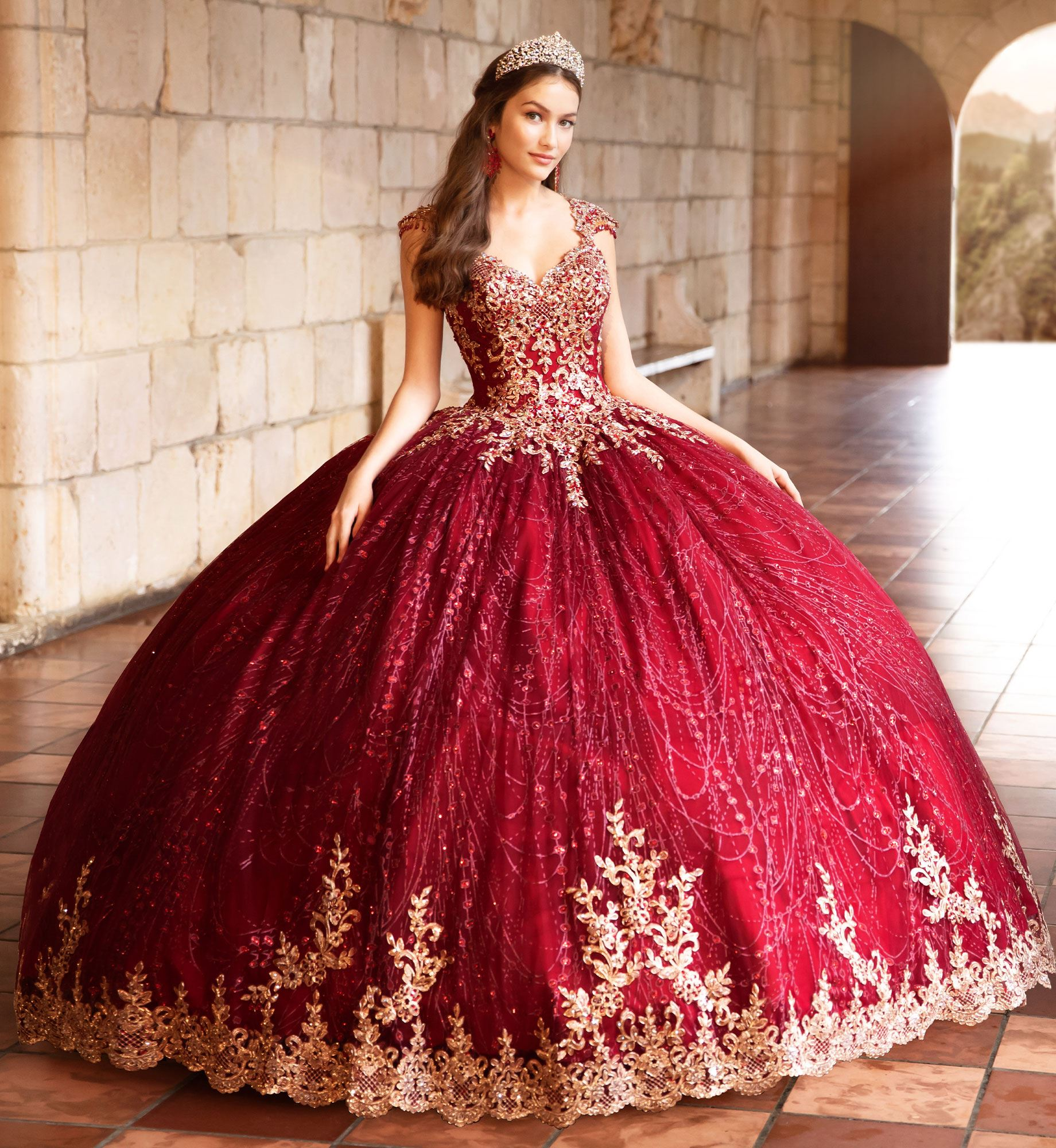 Brunette model in wine red and gold quinceañera dress