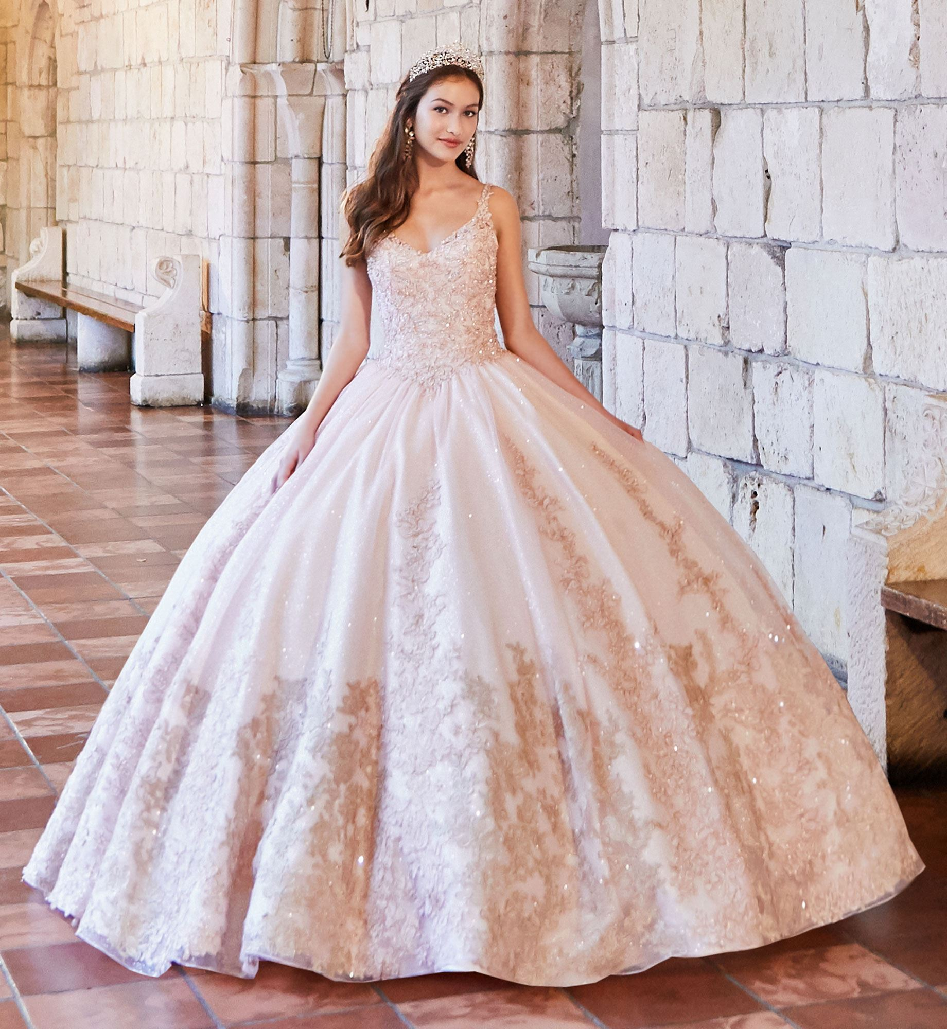 Brunette model in pink and gold quinceañera dress