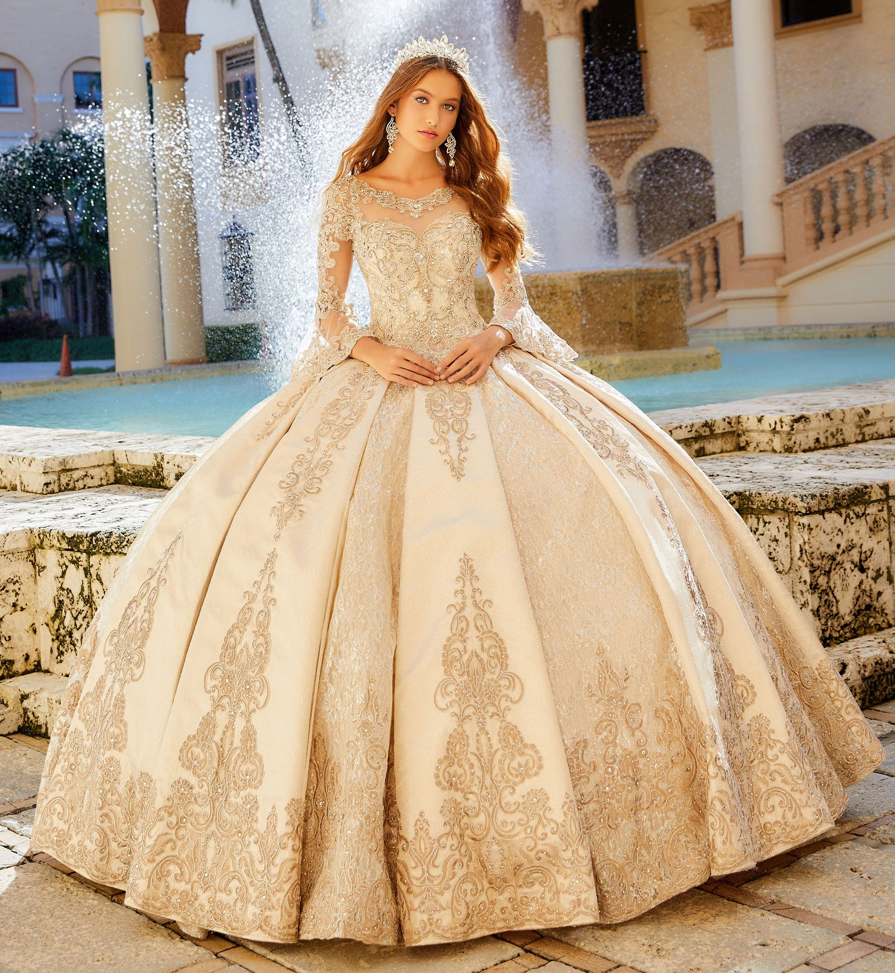 Brunette model in gold quinceañera dress with long sleeves
