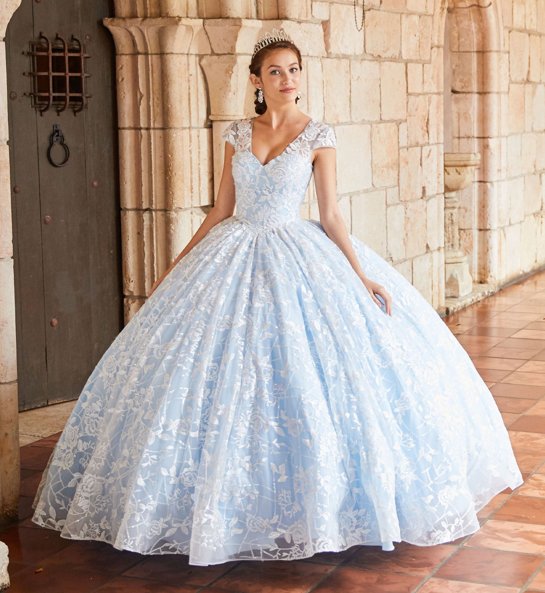 Brunette model in blue lace quinceañera dress