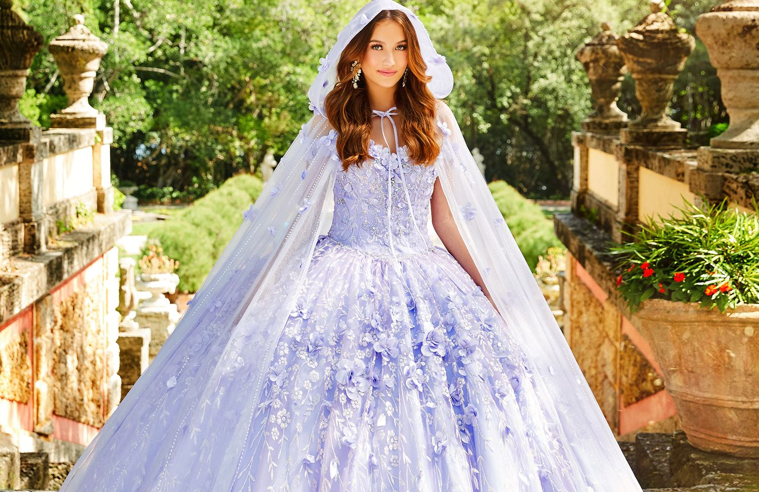 Brunette models in pink and purple quinceañera dresses mobile image